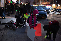 NEW YORK, NY - DECEMBER 11: Residents simulate of corpse risings silhouettes as they take part during a protest on  December 11,2019 in the Bronx New York City. Residents demand safe streets in response to the escalating violence between gangs, wounded five people, including a 10 and 14-year-old on this area nearly 4,000 students  attend school, daycare, and after-school programs in the 3-block radius of where this violence occurred.<br /> (Photo by Joana Toro/VIEWPress/Corbis via Getty Images)