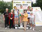 Marie brennan presents the trophys to Fiona Roche from Raheney AC first Niamh Devlin Dundrum South Dublin second and Emelia Dan Dunboyne AC third in the Dunleer 4 mile run, also in photo Pat Cheshire, Bernadette McGuill and david carrie. Photo: Colin Bell/Pressphotos.ie