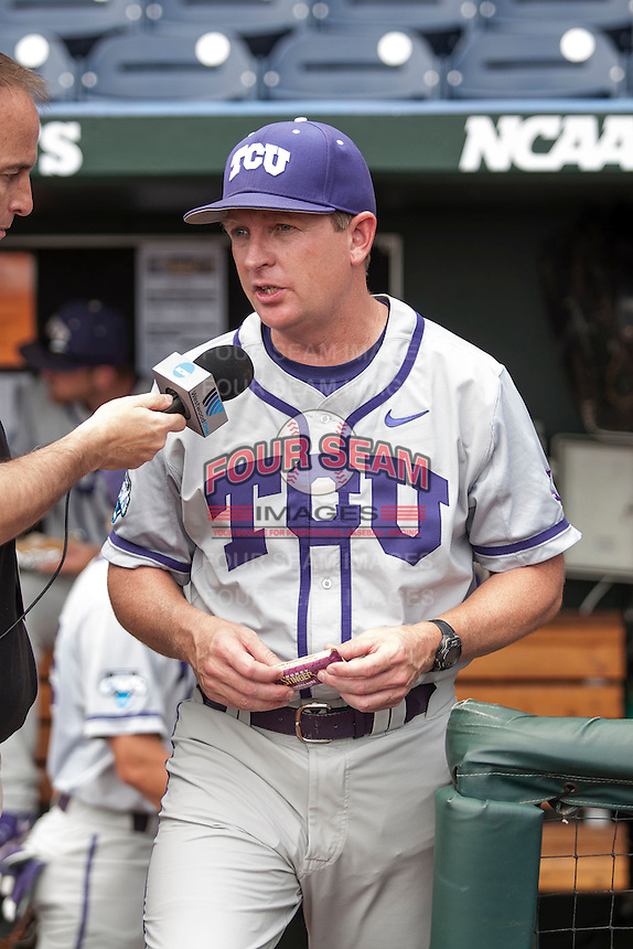 TCU Horned Frogs Head Coach Jim Schlossnagle (22) is interviewed before the NCAA College World Series fame against the LSU Tigers on June 14, 2015 at TD Ameritrade Park in Omaha, Nebraska. TCU defeated LSU 10-3. (Andrew Woolley/Four Seam Images)