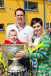 Daniel and Jetta Egan with their son Eamon in the Sam Maguire at the opening of the Cordal GAA pitch on Sunday