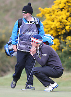 Thursday 28 May 2015; Matteo Manassero, Italy, looks at his putt on the 13th green<br /> <br /> Dubai Duty Free Irish Open Golf Championship 2015, Round 1 County Down Golf Club, Co. Down. Picture credit: John Dickson / SPORTSFILE