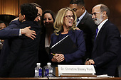 WASHINGTON, DC - SEPTEMBER 27:  Christine Blasey Ford (C) is surrounded by her attorney Michael Bromwich (R), supporters and her security guards after she testified before the Senate Judiciary Committee in the Dirksen Senate Office Building on Capitol Hill September 27, 2018 in Washington, DC. A professor at Palo Alto University and a research psychologist at the Stanford University School of Medicine, Ford has accused Supreme Court nominee Judge Brett Kavanaugh of sexually assaulting her during a party in 1982 when they were high school students in suburban Maryland.  (Photo by Win McNamee/Getty Images)