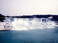 WATERFALL: NIAGARA FALLS IN WINTER<br /> Three States of Matter<br /> Water in solid, liquid and vapor states.