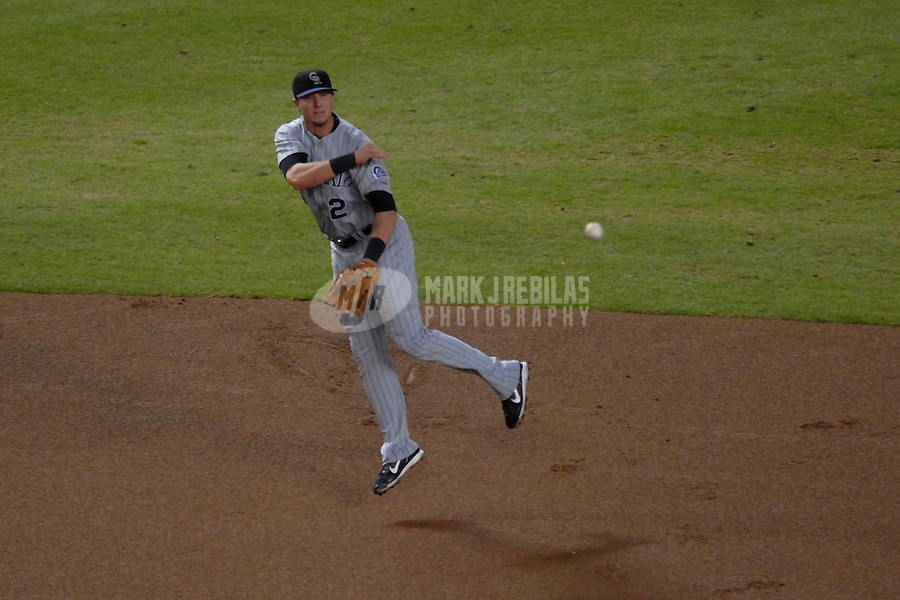 Oct 12, 2007; Phoenix, AZ, USA; Colorado Rockies shortstop (2) Troy Tulowitzki makes a play to first in the first inning against the Arizona Diamondbacks during game 2 of the 2007 National League Championship Series at Chase Field. Mandatory Credit: Mark J. Rebilas-US PRESSWIRE