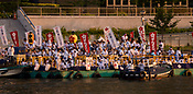 People starting the river stage of the Tenjin Festival parade in Osaka.
