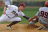 Mike Proios #10, Mepham shortstop, left, tries to nab Joe Keller #99 of MacArthur, who slides safely into second base for a stolen base in the top of the fifth inning of a Nassau County varsity baseball game at Mepham High School on Thursday, April 27, 2017. Mepham won by a score of 3-0.