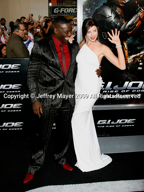 "HOLLYWOOD, CA. - August 06: Adewale Akinnuoye-Agbaje and Rachel Nichols arrive at a special screening of ""G.I. Joe: The Rise Of The Cobra"" on August 6, 2009 in Hollywood, California."