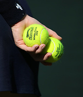 A close-up of two Wimbledon 2018 tennis balls held by a ball girl<br /> <br /> Photographer Rob Newell/CameraSport<br /> <br /> Wimbledon Lawn Tennis Championships - Day 5 - Friday 6th July 2018 -  All England Lawn Tennis and Croquet Club - Wimbledon - London - England<br /> <br /> World Copyright &not;&copy; 2017 CameraSport. All rights reserved. 43 Linden Ave. Countesthorpe. Leicester. England. LE8 5PG - Tel: +44 (0) 116 277 4147 - admin@camerasport.com - www.camerasport.com