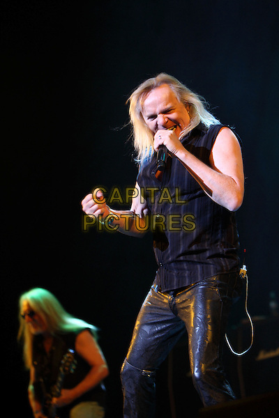 Uriah Heep .Concert in St. Petersburg, Russia..May 21st, 2009.on stage in concert live gig performance performing music half length black sleeveless top stripe leather trousers singing .CAP/PER/SB.© SB/Persona/CapitalPictures