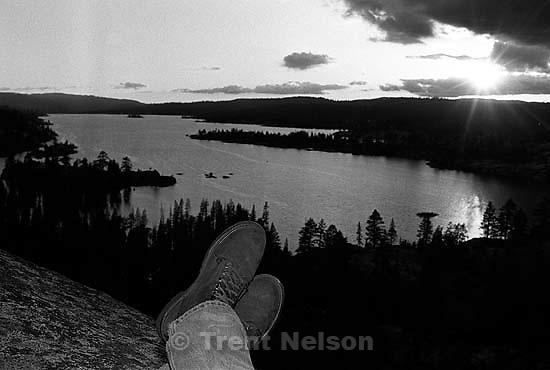 Trent feet and sunset over Spicer Reservoir at Sword Lake<br />