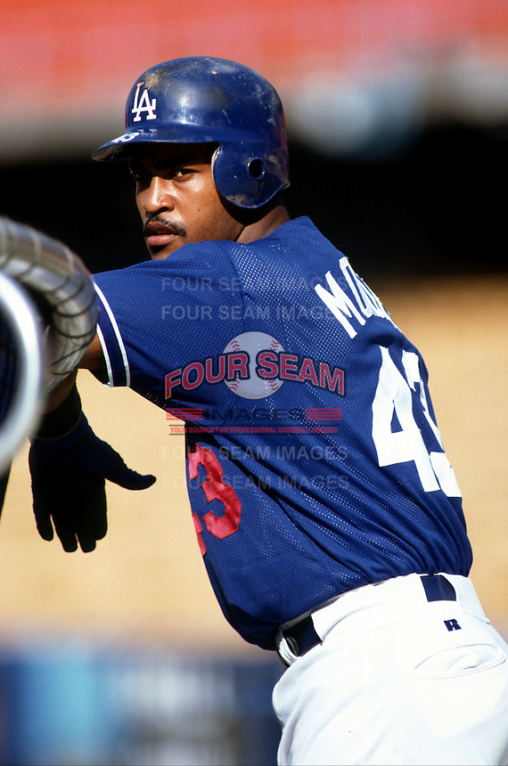 Raul Mondesi of the Los Angeles Dodgers at Dodger Stadium in Los Angeles,California during the 1996 season. (Larry Goren/Four Seam Images)