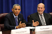 United States President Barack Obama meets with agriculture and business leaders on the benefits of the Trans-Pacific Partnership for American business and workers, at the Department of Agriculture in Washington, Tuesday, Oct. 6, 2015. At right is Bob Stallman, Jr., President, American Farm Bureau.<br /> Credit: Martin H. Simon / Pool via CNP
