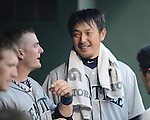 Hisashi Iwakuma (Mariners),<br /> JULY 4, 2013 - MLB :<br /> Hisashi Iwakuma of the Seattle Mariners talks with his teammate in the dugout during the Major League Baseball game against the Texas Rangers at Rangers Ballpark in Arlington in Arlington, Texas, United States. (Photo by AFLO)