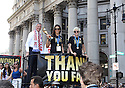 Mayor Bill De Blasio, US Women's Soccer players Carli Lloyd and Megan Rapinoe are seen during New York City Ticker Tape Parade For World Cup Champions U.S. Women's Soccer National Team on July 10, 2015 in New York City.(AP Photo/ Donald Traill)