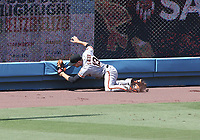 25th July 2020, Los Angeles, California, USA;  San Francisco Giants infielder Austin Slater (13) makes a catch during the game against the Los Angeles Dodgers on July 25, 2020, at Dodger Stadium in Los Angeles, CA.