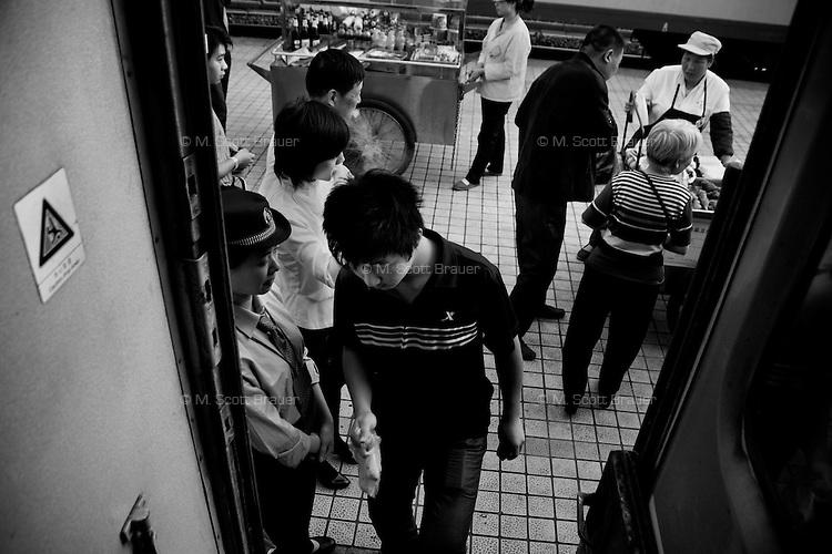 Passengers return to a train after a break in travel in Baoji, Sha'anxi, China.