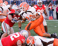 Bowling Green Running Back Chris Bullock finds a hole with the help of a hold on Ohio State Defensive Lineman Quinn Pitcock #90. Despite the extra help the Bowling Green Falcons were soundly beaten by the Ohio State Buckeyes 35-7 on October 07, 2006 at Ohio Stadium, Columbus, Ohio.
