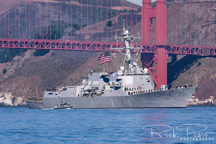 The guided-missile destroyer USS Pinckney (DDG 91) passes under the Golden Gate Bridge during the Parade of Ships as part of San Francisco's 2010 Fleet Week activities. The Pinckney is an Arleigh Burke-class destroyer named for Cook First Class William Pinckney (1915-1975), who received the Navy Cross for his courageous rescue of a fellow crewmember onboard Enterprise (CV-6) during the Battle of Santa Cruz.