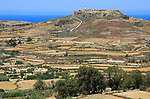 Rural landscape view from Zebbug to hilltop Ta 'Gurdan, Gordan or Gordon lighthouse, Gozo, Malta