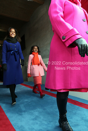 Washington, DC - January 20, 2009 -- Malia Obama, 10, and Sasha Obama, 7, right, arrive at the U.S. Capitol to see their father, President-elect Barack Obama, swear-in as the 44th President of the United States and the first African-American to lead the nation in Washington Tuesday, January 20, 2009. .Credit: J. Scott Applewhite - Pool via CNP