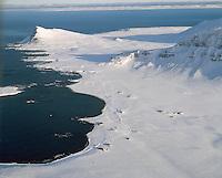 Árnes, Bær og Finnbogastaðir, Trékyllisvík, Reykjarneshyrna Árneshreppur, eyðibýlið  Reykjanes er við enda Reykjarneshyrna í miðri mynd / .Arnes, Baer and Finnbogastadir farms, church and school, Trekyllisvik - bay, Reykjarneshyrna mountain left in background. and the former farmsite Reykjanes is at the western foot of  the mountain,  Arneshreppur.