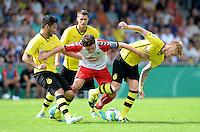 FUSSBALL       DFB POKAL 1. RUNDE        SAISON 2013/2014 SV Wilhelmshaven - Borussia Dortmund    03.08.2013 Ilkay Guendogan (li) und Marco Reus (re, beide Borussia Dortmund) gegen Matthias Tietz (Mitte, Wilhelmshaven)