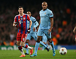 Robert Lewandowski of Bayern Munich marshalled by Vincent Kompany of Manchester City  - UEFA Champions League group E - Manchester City vs Bayern Munich - Etihad Stadium - Manchester - England - 25rd November 2014  - Picture Simon Bellis/Sportimage