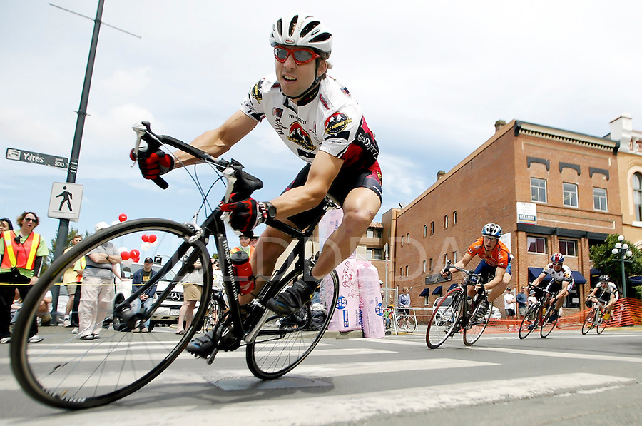 """Cyclists lean into """"crash corner"""" during a race at Yates and Wharf Streets in Victoria, British Columbia. Photo assignment for the Victoria Times Colonist newspaper."""