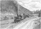 A south facing panoramic view of Brown station and area with leased D&amp;RGW #464 heading out with a northbound freight.  Leased D&amp;RGW #461 is cut in as a helper.  B&amp;B cars are on the siding.<br /> RGS  Brown, CO  Taken by Richardson, Robert W. - 9/16/1946