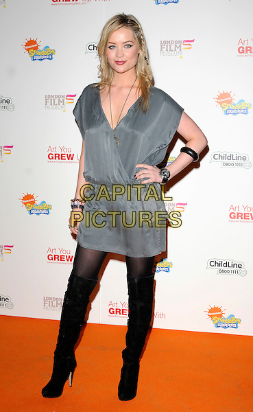 LAURA WHITMORE.Attending the charity auction of SpongeBob SquarePants Artwork, London, England. .January 21st, 2010.full length grey gray dress hand on hip v-neck otk over the knee high thigh boots bracelets tunic .CAP/CAN.©Can Nguyen/Capital Pictures.