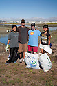 "Left to right: Peter from Mills High School, Carlos Rivera, Christina Stevens from the Community Preservation Commission, and Shorhon Gong from Aragon High School cleaning up Bayfront Park. Volunteers in the City of Millbrae participated in California Coastal Cleanup Day on 9/19/09. Participants cleaned up inland locations throughout the city as well as at Bayfront Park on the San Francisco Bay shoreline. The inland cleanup efforts were important because, according to the California Coastal Commission, ""past Coastal Cleanup Day data tell us that most (between 60-80 percent) of the debris on our beaches and shorelines comes from inland sources, traveling through storm drains or creeks out to the beaches and ocean. Rain or even something as simple as hosing down a sidewalk can wash cigarette butts, bits of styrofoam, pesticides, and oil into the storm drains and out to the ocean."" The California Coastal Cleanup Day (http://www.coastal.ca.gov/publiced/ccd/ccd.html) is sponsored by the California Coastal Commission and is a part of the International Coastal Cleanup organized by The Ocean Conservancy."