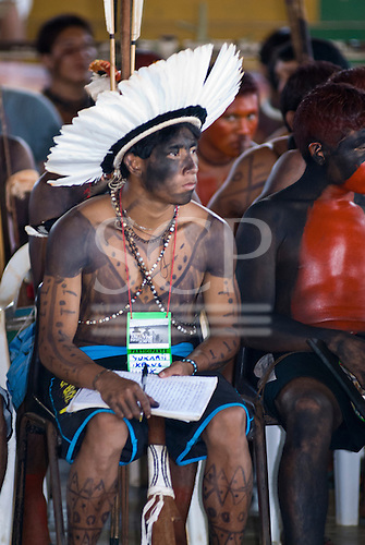 "Altamira, Brazil. ""Xingu Vivo Para Sempre"" protest meeting about the proposed Belo Monte hydroeletric dam and other dams on the Xingu river and its tributaries. A young Ikpeng leader Kay Yukari, takes notes of the presentations."