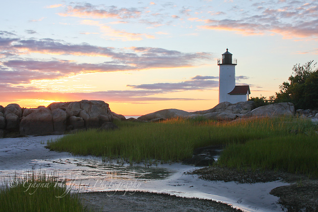 Lighthouse and rocky coast in sunset. Annisquam Light, Gloucester, MA