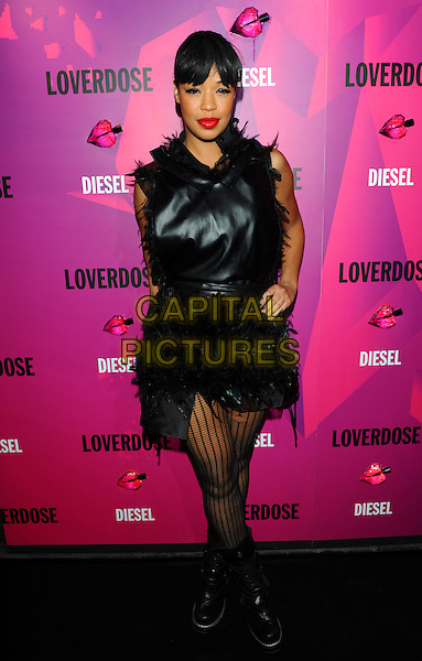 "Sarah Jane Crawford.Attends the Diesel ""Loverdose"" fragrance launch party, The Box, Brewer Street, London, England..September 7th, 2011.full length black dress hand on hip feathers pattern tights.CAP/CJ.©Chris Joseph/Capital Pictures."