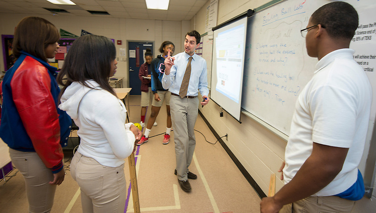 Physics teacher Adeeb Barqawi works with his students at Kashmere High School, April 14, 2014.
