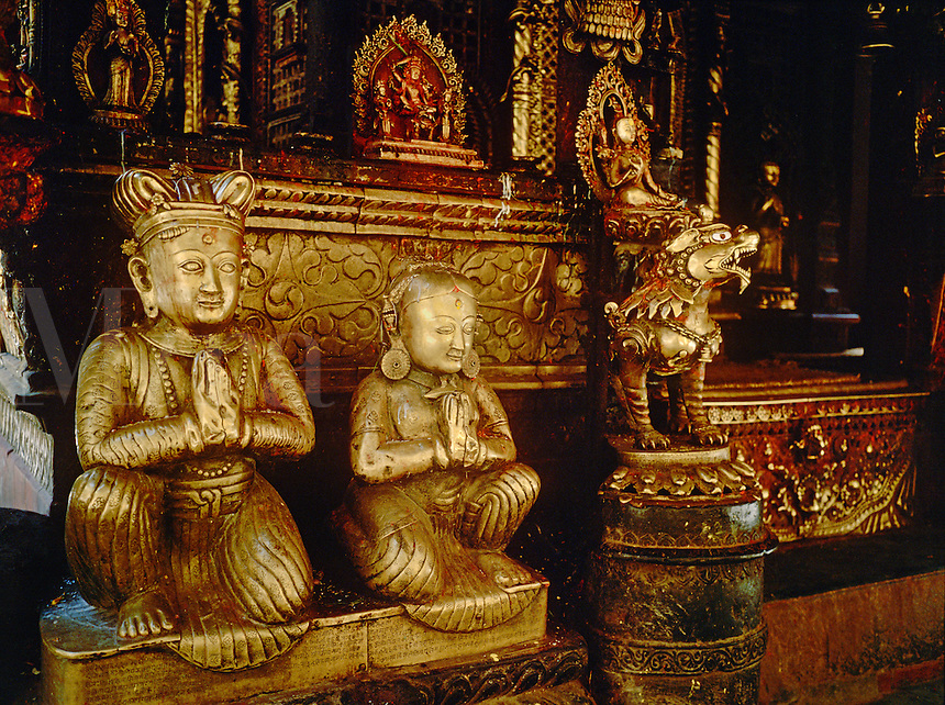Gold gilded bronzes of the MALLA KING & QUEEN inside THE GOLDEN TEMPLE - PATTAN, NEPAL