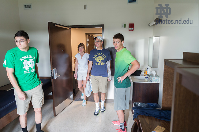 """August 19, 2016; First year student Patrick Quinn from Portland, OR and his parents Jerry '89 and Kristin '89 look over his Dunne Hall dorm room for the first time on move-in day of Welcome Weekend 2016. """"This isn't a dorm, it's a hotel,"""" said Jerry. (Photo by Matt Cashore/University of Notre Dame)"""