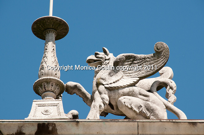 A stone gryphon in Como, Italy