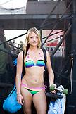 USA, Hawaii, Oahu, portrait of a beautiful young woman in bikini holding skateboard, Waimea Bay