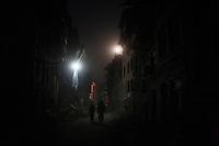 People walk at night in the streets of Bhaktapur, near Kathmandu, Nepal. May 04, 2015