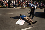 April 26, 2008. Raleigh, NC.. Heralded as the largest Support the Troops parade in North Carolina history, thousands of people turned to watch floats and displays from all divisions of the US military parade through downtown Raleigh, NC.. A single protester laid down in front of the parade to challenge US involvement in Iraq. He was quickly escorted from the route.