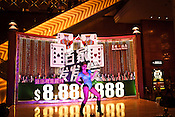 A Chinese performer entertains the crowd on stage at the Venetian Macau Resort Hotel in Macau, China.