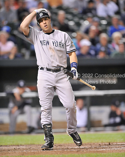 Baltimore, MD - September 1, 2009 -- New York Yankees first baseman Mark Teixeira (25) shows his unhappiness after lining out in the seventh inning against the Baltimore Orioles at Oriole Park at Camden Yards in Baltimore, MD on Tuesday, September 1, 2009.  The Yankees won the game 9 - 6..Credit: Ron Sachs / CNP.(RESTRICTION: NO New York or New Jersey Newspapers or newspapers within a 75 mile radius of New York City)