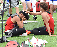 RICK PECK/SPECIAL TO MCDONALD COUNTY PRESS McDonald County pole vaulter Zach Woods consoles teammate Huechi Xiong after Xiong went out early in the event at the Missouri Class 4 District 2 Track and Field Championships on May 11 at Carl Junction High School. Woods, a two-time state qualifier, went on to clear 13-9, but finished in fifth place and failed to advance to this week's sectional meet in West Plains.