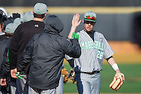 Marshall Thundering Herd left fielder Cory Garrastazu (28) high fives teammates following their win over the Georgetown Hoyas at Wake Forest Baseball Park on February 15, 2014 in Winston-Salem, North Carolina.  The Thundering Herd defeated the Hoyas 5-1.  (Brian Westerholt/Four Seam Images)