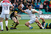 9th September 2017, Franklins Gardens, Northampton, England; Aviva Premiership Rugby, Northampton Saints versus Leicester Tigers; Matt Toomua of Leicester Tigers is tackled by Rob Horne and Luther Burrell of Northampton Saints