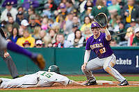 LSU Tigers first baseman Danny Zardon (27) catches a pickoff throw as Baylor Bears baserunnner Adam Toth (15) dives back to the bag during the NCAA baseball game on March 7, 2015 in the Houston College Classic at Minute Maid Park in Houston, Texas. LSU defeated Baylor 2-0. (Andrew Woolley/Four Seam Images)