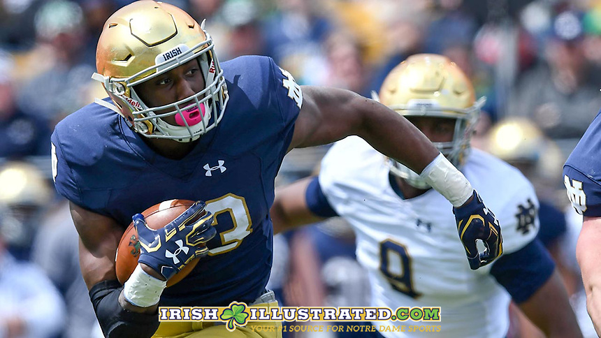 Running back Josh Adams (33) carries in the first quarter.