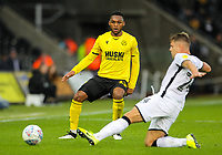 23rd November 2019; Liberty Stadium, Swansea, Glamorgan, Wales; English Football League Championship, Swansea City versus Millwall; Mahlon Romeo of Millwall passes the ball forward - Strictly Editorial Use Only. No use with unauthorized audio, video, data, fixture lists, club/league logos or 'live' services. Online in-match use limited to 120 images, no video emulation. No use in betting, games or single club/league/player publications