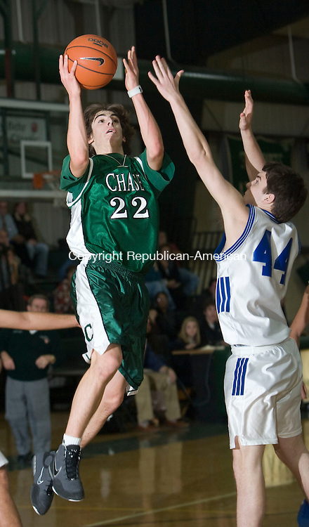 WATERBURY, CT - 26 JANUARY 2009 -012609JT08-<br /> Chase Collegiate's Marty Malaspina goes for a layup around Williams' #44 (not listed in roster) during Monday's game at Chase. Chase won 63-47.<br /> Josalee Thrift / Republican-American